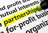 pic of partnership  - Partnership concept with a 3d rendering of business related words on a paper document and partnership text highlighted with a yellow marker - JPG