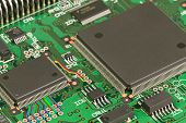 picture of processor  - Processor and memory chips on a green circuit board - JPG