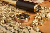 picture of gold nugget  - Gold nuggets and vintage brass telescope on antique map  - JPG