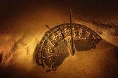 foto of sundial  - Sundial in sand - JPG