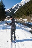 picture of nordic skiing  - Teen age boy enjoying cross country skiing in Alp - JPG