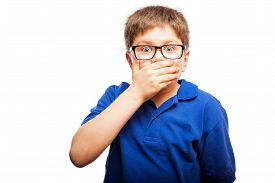 stock photo of shock awe  - Little blond boy covering his mouth with a hand as a sign of shock and secrecy - JPG