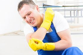 picture of elbow  - Man worker with elbow injury - JPG