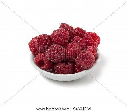 Ripe Raspberry On A Saucer. Isolated On White Background