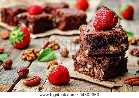 Chocolate Nut Brownie Cake Decorated With Strawberries