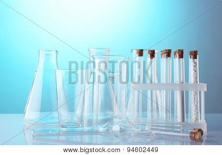 Empty laboratory test tubes  on blue background