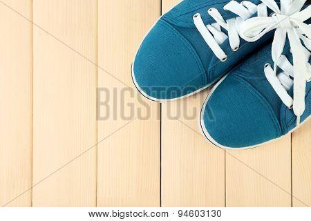 Female gumshoes on wooden background