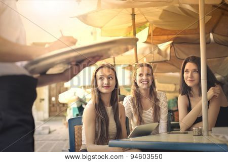 Girls ordering a meal at the restaurant