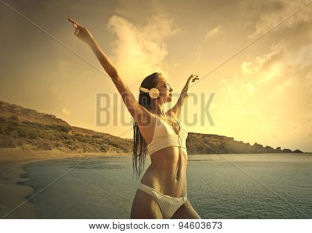 Woman enjoying music at the beach