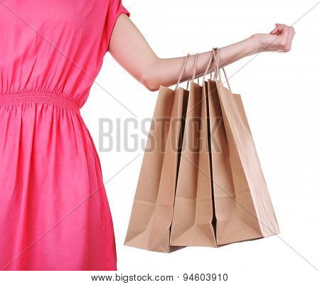 Woman holding paper shopping bag isolated on white