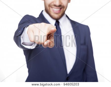 Smiling business man pointing the finger at you, isolated on white background