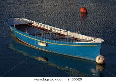 a blue small boat
