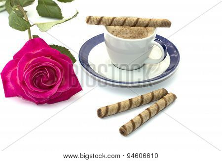 Cup Of Coffee On A Saucer And A Bright Rose