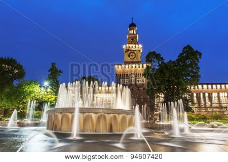 Night photo of Sforza Castle (Castello Sforzesco) in Milan, Italy