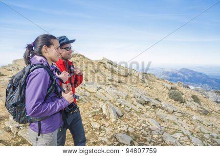 Couple Enjoying The Mountains