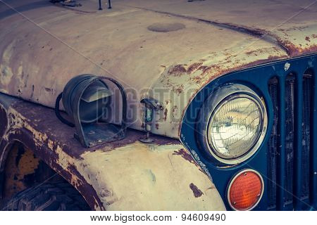 Headlight of a vintage car ( Filtered image processed vintage effect. )