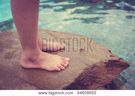 Female legs at swimming pool