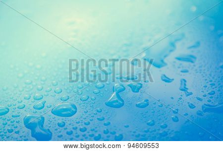 Drops of water on blue floor