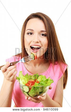 Young woman with glass bowl of diet salad isolated on white