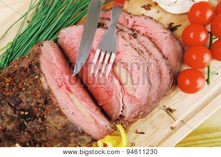 beef barbecue served on big wooden plate