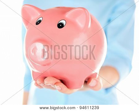 Woman holding piggy bank close up