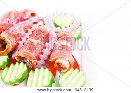 fresh served roasted meat rolls on white platter