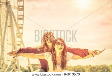 Best Friends Enjoying Time Together Outdoors At Ferris Wheel - Concept Of Freedom And Happiness