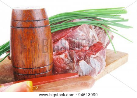 main course : fresh raw beef steak entrecote ready to prepare on cut board with green chives and tomatoes isolated on white background