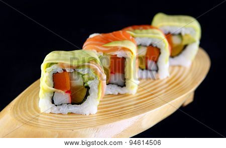 Maki salmon sushi with cheese in a black background