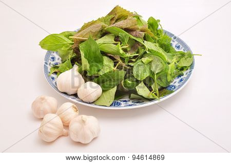 Herbs and garlic on a white background
