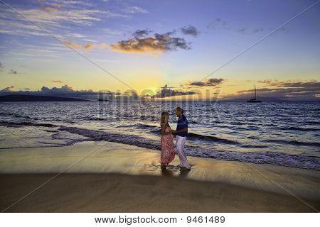 couple walking on a maui beach