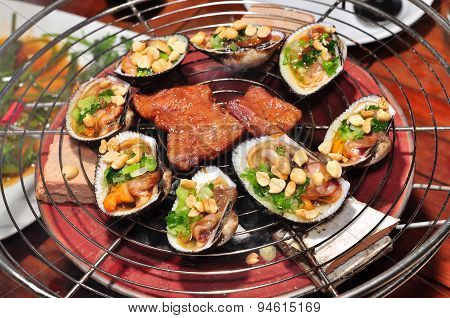 Shell steaks on the grill in the restaurant