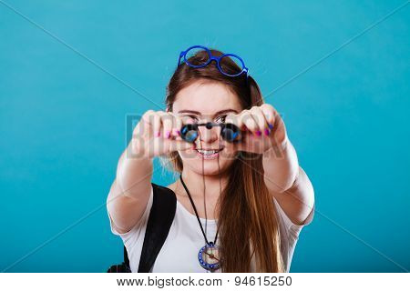 Tourist Woman Looking Through Binoculars On Blue