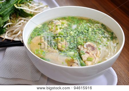 Pho or Vietnamese rice vermicelli noodle with beef or chicken on the table