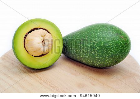 Avocado on the cutting board in a white background
