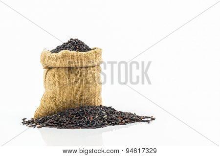 Rice Berry In Small Burlap Sack .