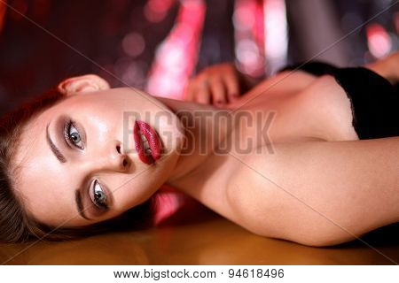 Close-up portrait of beautiful girl with trendy makeup lying.
