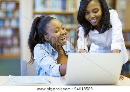 modern african american college students using laptop