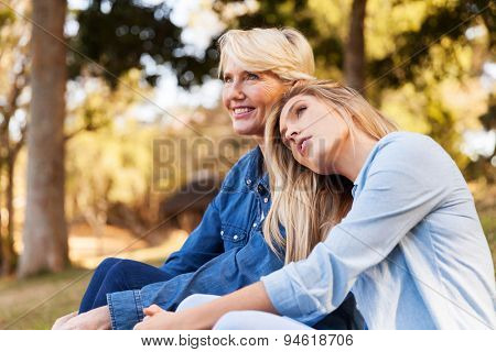 gorgeous mother and daughter relaxing outdoors