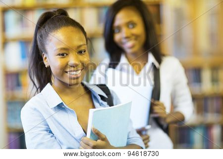 african american college girl with friend on background