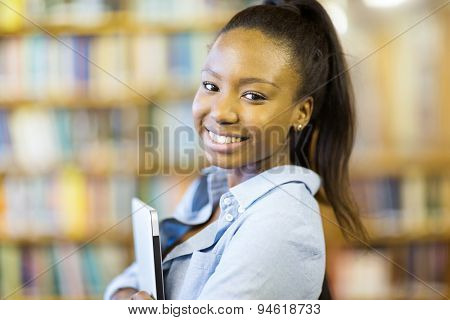 beautiful young african college girl holding laptop