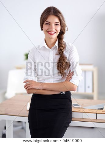 Attractive businesswoman with her arms crossed stnding