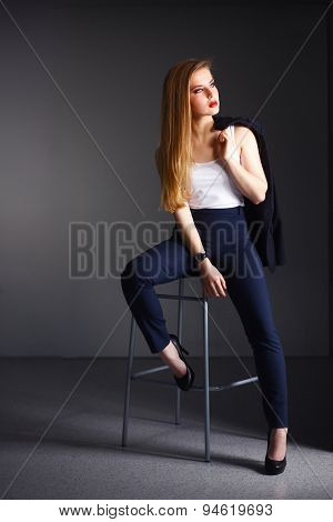 Young woman sitting on a chair .