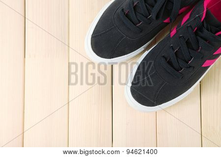 Female gumshoes on wooden background