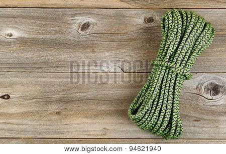 New Nylon Climbing Rope On Rustic Wooden Boards