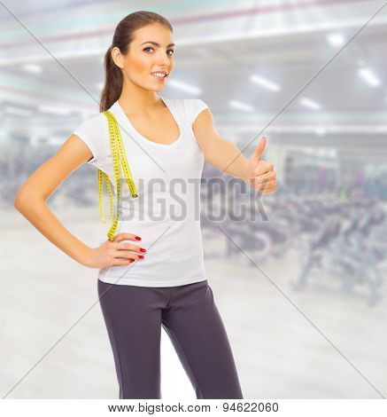 Sporty young girl at fitness club
