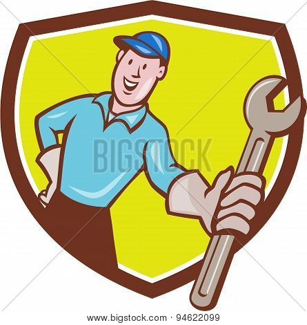 Mechanic Presenting Wrench Shield Cartoon