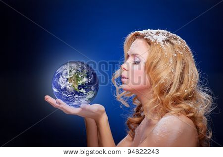 Frozen girl holding earth globe (west hemispere) in palms (elements furnished by NASA)