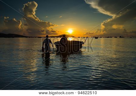 Unidentified fishermen work on the beach in Binhthuan,