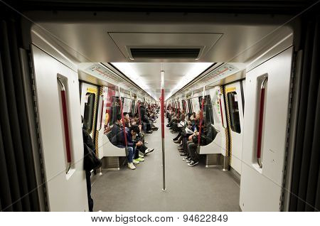 Commuters inside a subway train in Hong Kong